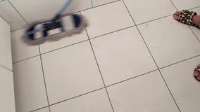 Mop sweeping tile. stock footage