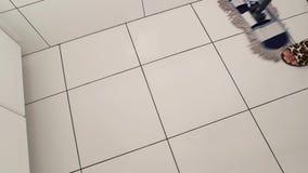 Mop is sweeping tile. stock footage