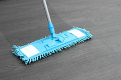 Mop washing wooden floor Royalty Free Stock Photos