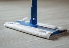 Mop with a wet cloth on linoleum. stock images