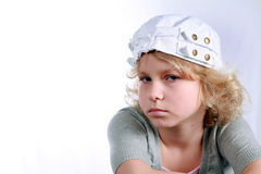 Mope. Close up  of pretty little blonde girl in hat Stock Images
