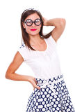 Mope-eyed woman. Young myopic woman in polka dots dress wearing black framed glasses with prescription. Isolated Royalty Free Stock Photography