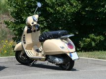 Moped. Photo of a fashionable small moped parked near park Royalty Free Stock Image