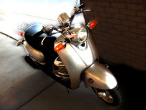 Moped. Sitting on sidewalk, clean and polished Royalty Free Stock Image