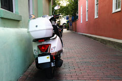 Moped in an Alley. A parked moped in an alley in St. Augustine, Florida Royalty Free Stock Images