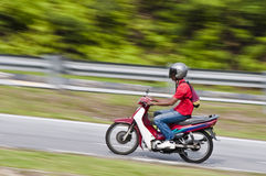 Moped motorcyclist Royalty Free Stock Photography