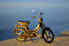 Moped on the shore Stock Photos