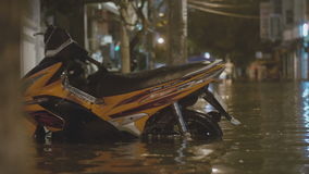 Moped stands on a flooded street. After heavy rains stock footage