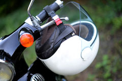 Moped. White helmet on retro moped Stock Image