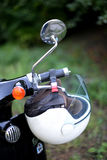 Moped. White helmet on retro moped Stock Photos