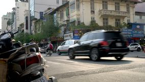 Mopeds, motorcycles, cars, bicycles and people on the streets of Ho Chi Minh City near Ben Thanh Market. Mopeds and People on The Streets of Ho Chi Minh City or stock video footage