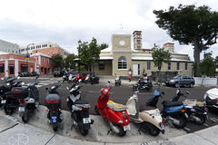 Mopeds parked on Reid Street in Hamilton- Bermuda Stock Photo