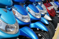 Mopeds or Scooters for Hire Stock Photography