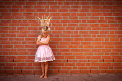 Moping princess. A moping princess in front of a wall with a sketch of her crown on it Stock Image