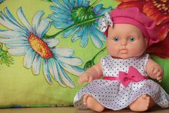 Moppet doll sitting on a flower Royalty Free Stock Photos