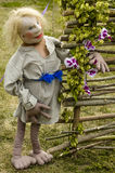 Moppet. A rag doll in a wicker fence on the background of nature Stock Images