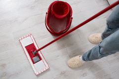 Mopping floor at home. Close up Stock Photo