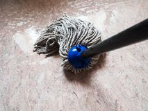 Mopping floor by rope mop. Point-of-view shot of mopping floor by rope mop stock photography