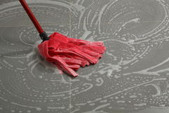 Mopping the floor tiles