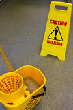 Mopping floor warning sign Stock Photos
