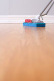 Mopping hardwood floor. With a sponge mop Royalty Free Stock Image