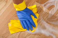Mopping up the floor. Cleaning the wooden floor by rubber Royalty Free Stock Images