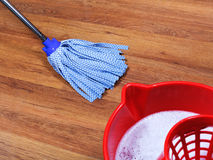 Mopping of wooden floors Stock Photos
