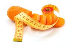 Morötter och linje Arkivfoto