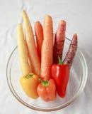 Morötter och pepparlutning Arkivbild
