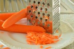 Morötter och spisgaller Royaltyfria Bilder