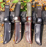 Mora Clipper 860 and 510 MG knives. Home-made bushcraft leather sheaths for Mora Clipper 860 and 510 MG knives royalty free stock photos