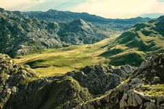 Moraca Mountains in Montenegro. Green meadow between the mountains of Montenegro royalty free stock image