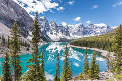 Moraine lake in Banff National Park, Canadian Rockies, Canada. Beautiful Moraine lake in Banff National Park, Canadian Rockies, Canada. Sunny summer day with Royalty Free Stock Images