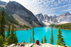 Moraine lake. Beautiful turquoise waters of the Moraine lake with snow-covered peaks above it in Banff National Park of Canada Royalty Free Stock Photography