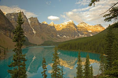Moraine Lake in the Canadian Rockies. A view of Moraine Lake in the Canadian Rockies in the early morning light, with reflections of the Wenkchemna Peaks in the stock photo