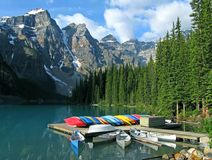 Moraine Lake with canoes. Morning at Moraine Lake with canoes, Alberta, Canada royalty free stock photos