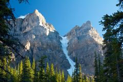 Moraine Lake Glacier. Two mountain tops and a glacier on Moraine Lake, Canada Royalty Free Stock Photography