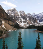 Moraine lake and mountain peaks royalty free stock photography