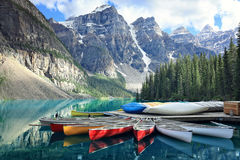 Moraine lake in the Rocky Mountains, Alberta, Canada. Canoes on a jetty at Moraine lake, Banff national park in the Rocky Mountains, Alberta, Canada