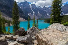 Moraine Lake in the Rocky Mountains. Moraine Lake is a beautiful mountain lake nestled in the Rocky Mountains in Banff National Park in Canada. Evergreen Trees Royalty Free Stock Photos