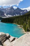 Moraine Lake in the Rocky Mountains. Moraine Lake is a beautiful mountain lake nestled in the Rocky Mountains in Banff National Park in Canada. Evergreen Trees stock photo