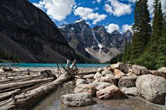 Moraine Lake in the Rocky Mountains. Moraine Lake is a beautiful turquoise mountain lake nestled in the snow covered Rocky Mountains in Banff National Park in stock photo
