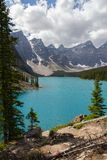 Moraine Lake in the Rocky Mountains. Moraine Lake is a beautiful turquoise mountain lake nestled in the snow covered Rocky Mountains in Banff National Park in stock photography