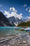 Moraine lake scenic. Scenic view of boats moored on Moraine lake with Ten Peaks mountains in background, Banff National Park, Alberta, Canada stock images