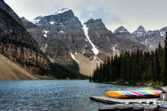 Moraine lake scenic. Scenic view of colorful boats moored on Moraine lake with Valley of the Ten Peaks mountain range in background, Banff Nation Park, Canada stock photos