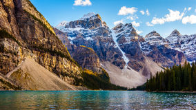 Moraine Lake and the surrounding snow capped mountains. In Banff National Park in the Canadian Rockies under blue sky Stock Photography