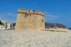 Moraira Castle, Moraira Seafront, Costa Blanca, Spain. Castillo de Moraira or Moraira Castle has a commanding view overlooking the bay and once helped defend the Stock Photo