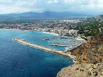 Moraira, Costa Blanca, Spain, Europe. View onto Moraira town and yacht harbour from the near hill Cap d`Or. Costa Blanca, Spain Royalty Free Stock Images