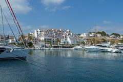 Moraira harbour and yacht club, Moraira, Costa Blanca, Spain. The harbour at Moraira, Costa Blanca, Spain. Yachts are moored and the yacht club is seen in the Royalty Free Stock Image