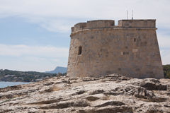 Moraira Tower. Defensive Tower in Moraira on Costa Blanca in Spain Royalty Free Stock Images